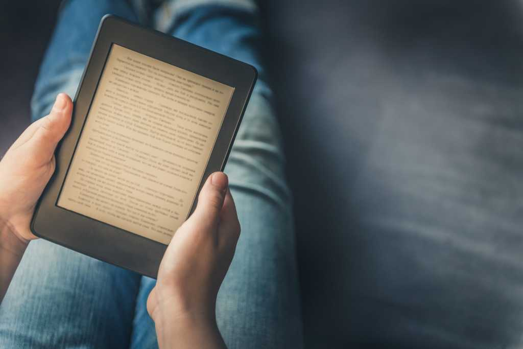 person reading kindle tablet
