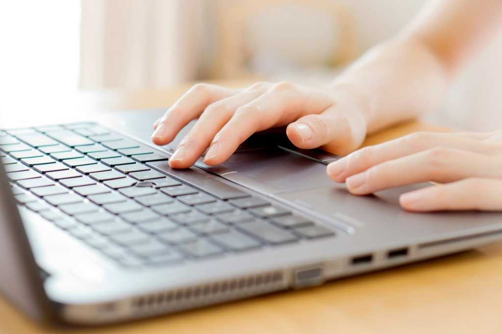 laptop touchpad womens hands