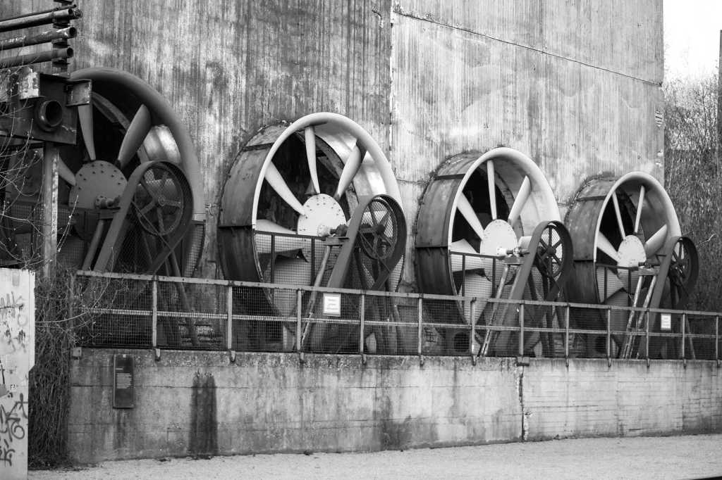 Four industrial fans on a building