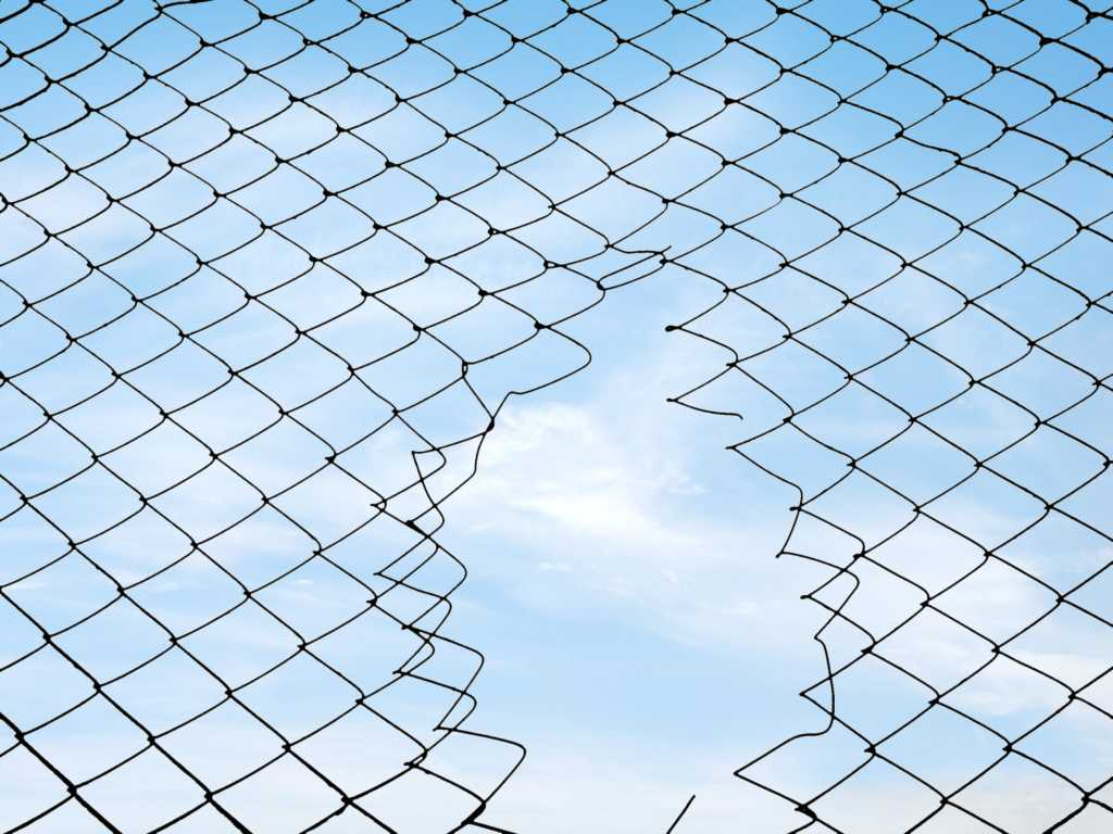 security hole in fence clouds gap opening