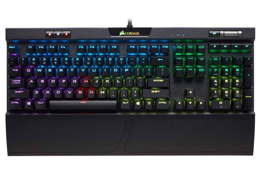 a corsair mechanical keyboard with RGB lighting activated on a white background