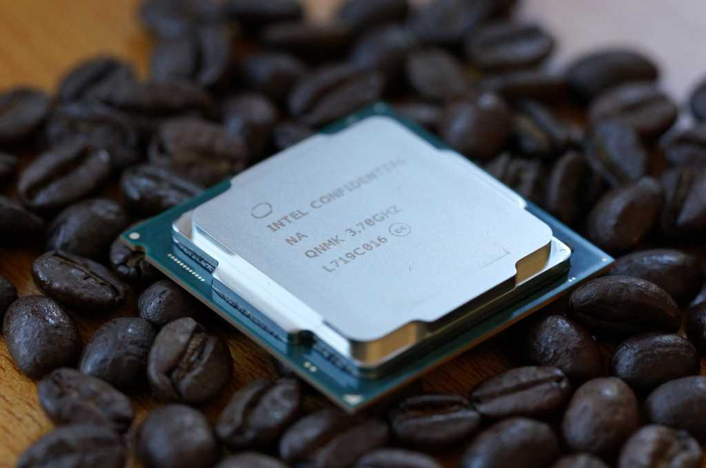 intel core i7-8700K on top of coffee beans on top of a table