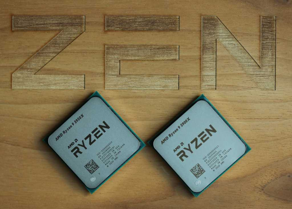 Ryzen 5950X and 5900X on a wood box with the word Zen on it